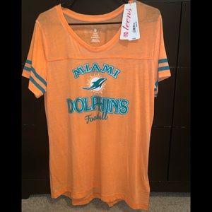 Miami Dolphins tee shirt.